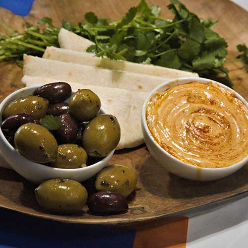 Hummus dip with Olives and pita bread